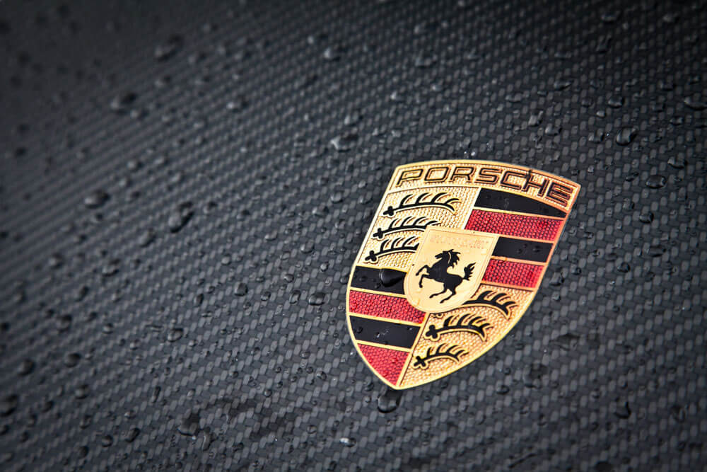 Porsche Badge Carbon Fibre Background